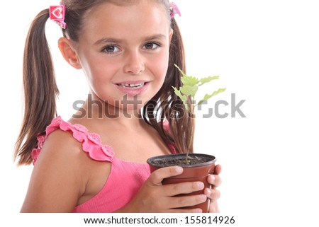 Girl with a plant - stock photo