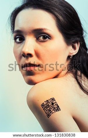 Girl with a QR code on shoulder, the protection personal data