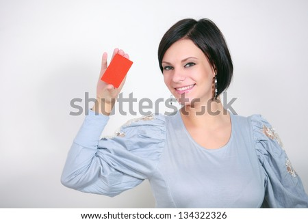 girl with a red card of on a white background - stock photo