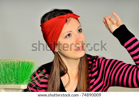 Girl with a red handkerchief on his head preparing to clean the apartment - stock photo