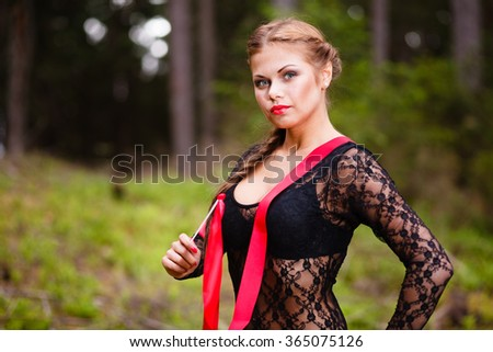 Girl with a red ribbon at forest. - stock photo