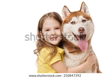 Girl with a redhead husky - stock photo