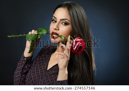 girl with a rose in his teeth - stock photo