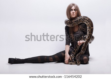 Girl with a snake - stock photo