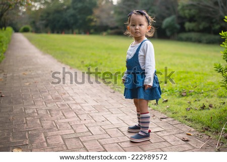 Girl with a stuffed toy bear - stock photo