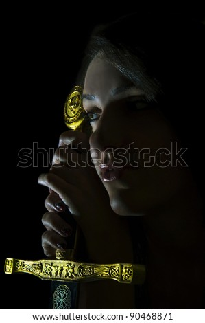 Girl with a sword on a black background - stock photo