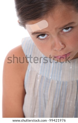 Girl with a wound on the forehead - stock photo