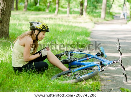 girl with an injury from a fall from a bicycle - stock photo