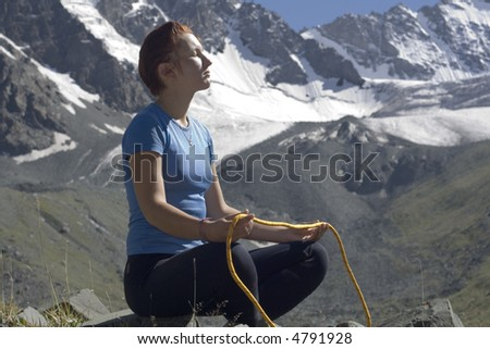 Girl with an orange rope in the mountains
