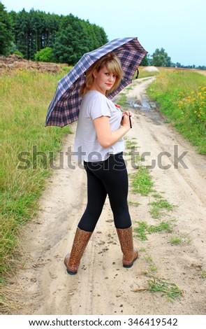 Girl with an umbrella - stock photo
