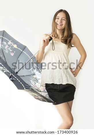 girl with an umbrella in the studio - stock photo