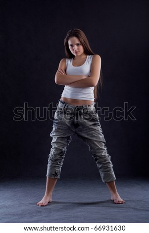 Girl with arms crossed - stock photo