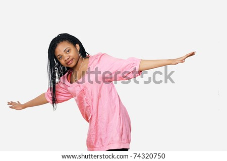 Girl with arms outstretched balancing or ready to fly - stock photo