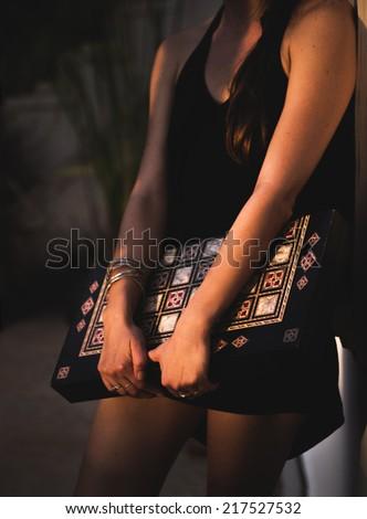 Girl with Backgammon Board at Dusk - stock photo