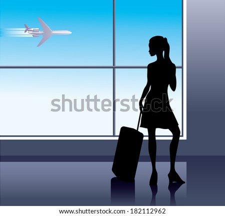 Girl with baggage in airport - stock photo