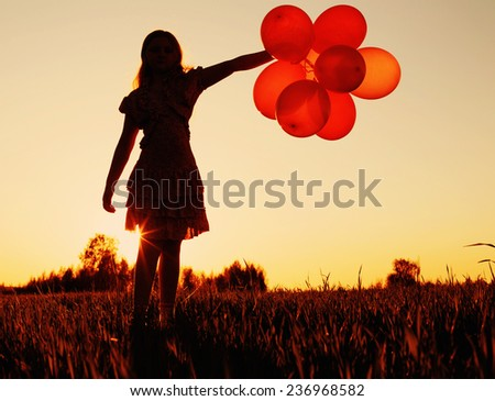 girl with balloons outdoor - stock photo