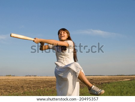 girl with baseball bat in the field - stock photo
