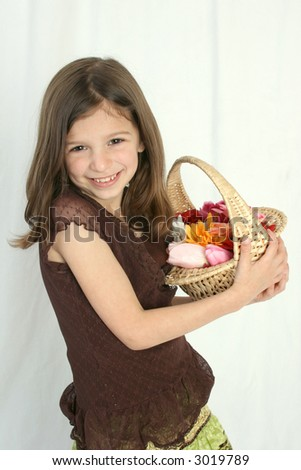 girl with basket of flowers - stock photo