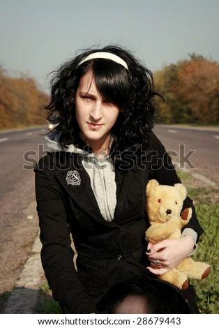 Girl with bear - stock photo