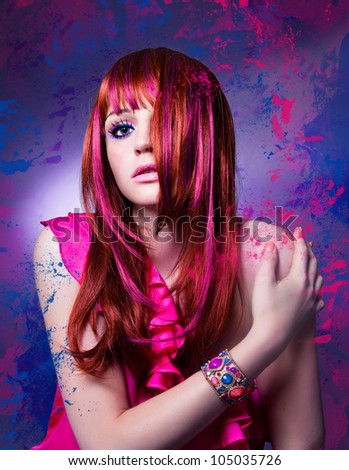 girl with beautiful colored red hair and flashy make-up - stock photo