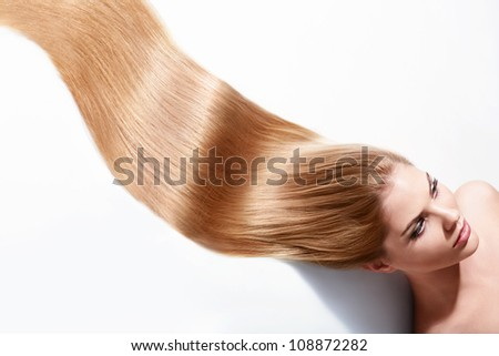 Girl with beautiful hair on a white background - stock photo