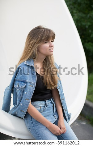 girl with beautiful hair posing in the street