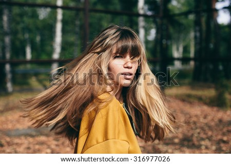 girl with beautiful hair turns around and looks at the camera - stock photo