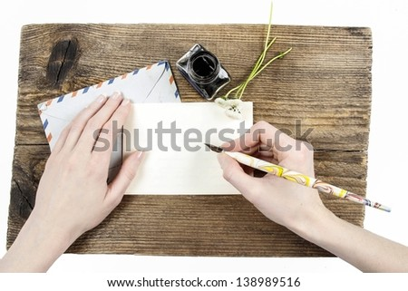 Girl with beautiful hands writing a letter - stock photo