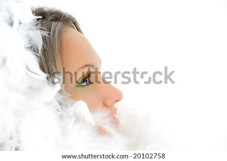 girl with beautiful makeup and white feathers - stock photo
