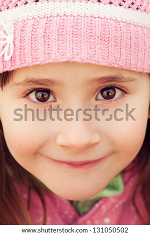 Girl with big brown eyes closeup looking into the camera - stock photo