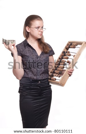 Girl with big wooden accounts and money on a white background