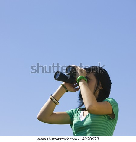 Girl with binoculars - stock photo