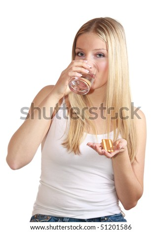 Girl with birth control pills - stock photo
