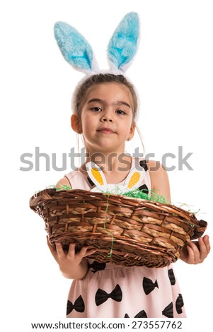 Girl with blue bunny ears holding basket with eggs isolated on white background - stock photo