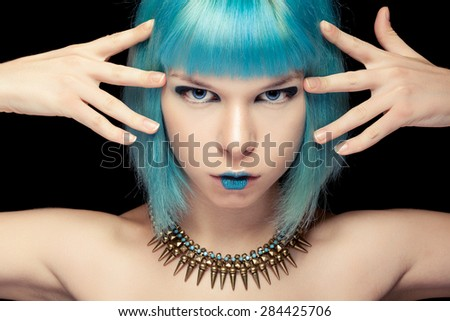 Girl with blue hair and make up over black background. Fashion make up and beauty. Anime style - stock photo