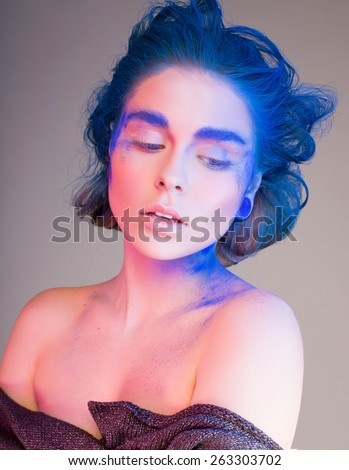 girl with blue hair, eyebrows and powder - stock photo