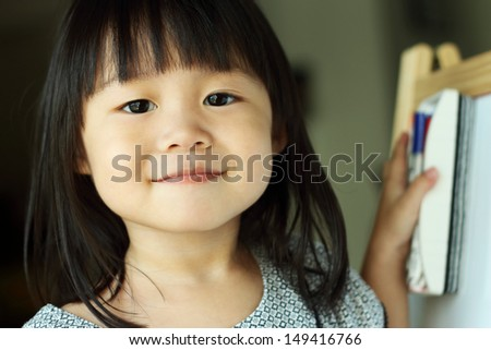 Girl with board eraser - stock photo