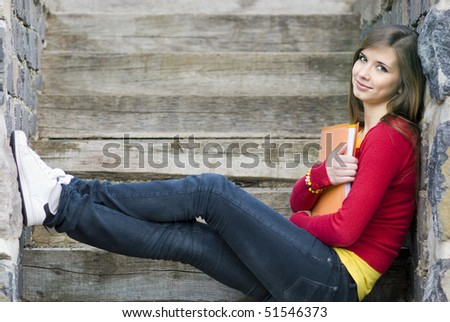Girl with book is taking rest.