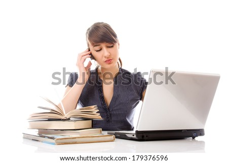 girl with books and laptop isolated on white background - stock photo