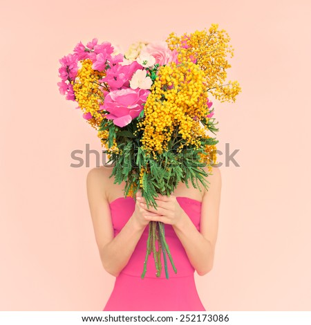 Girl with bouquet of flowers in her hands. Flowers, Spring, Romance, March 8 - stock photo