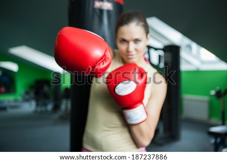 Girl with boxing gloves - stock photo