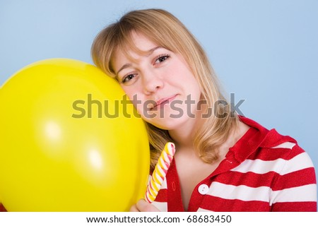 Girl with brackets with toy balloon and candy