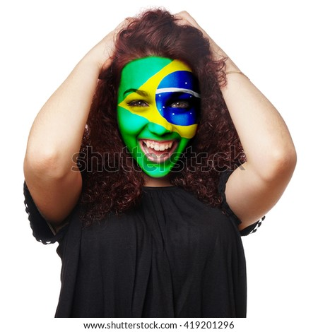 girl with brazilian flag face paint. female soccer fan from brazil.              - stock photo