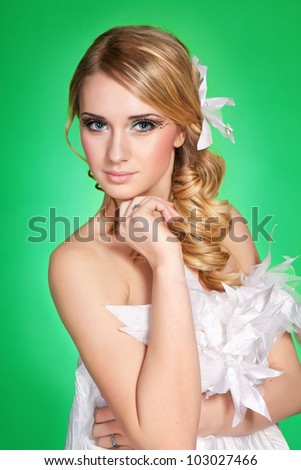 girl with bright makeup and expressive eyes. studio shoot at green background - stock photo