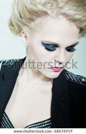 girl with bright makeup on the eyes - stock photo