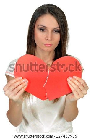 Girl with broken heart concept isolated on white - stock photo