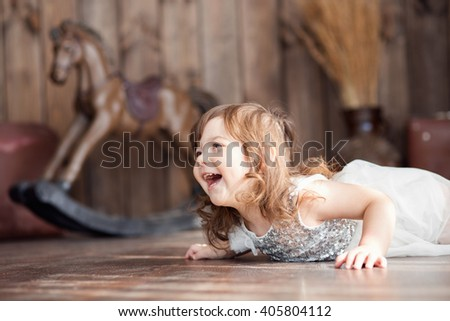 girl with brown hair on the background of wood with a horse - stock photo
