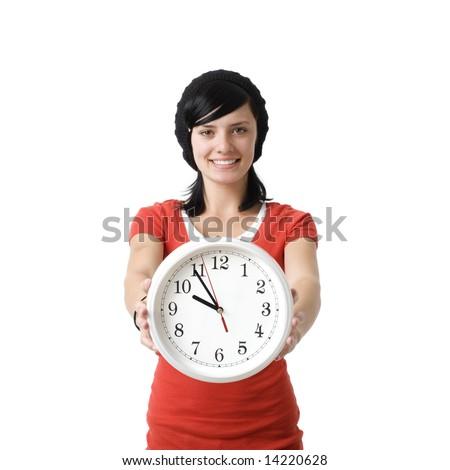 Girl with clock smiles - stock photo
