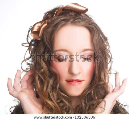 Girl  with closed eyes and curly hair.