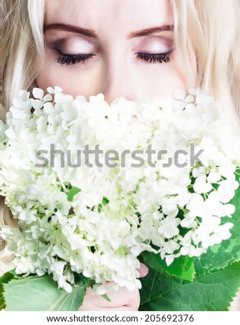 girl with closed eyes with flowers close up - stock photo